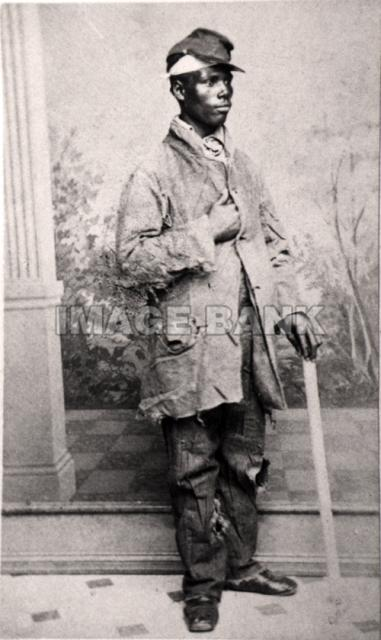aa17d black man with bandaged head in tattered clothes wearing